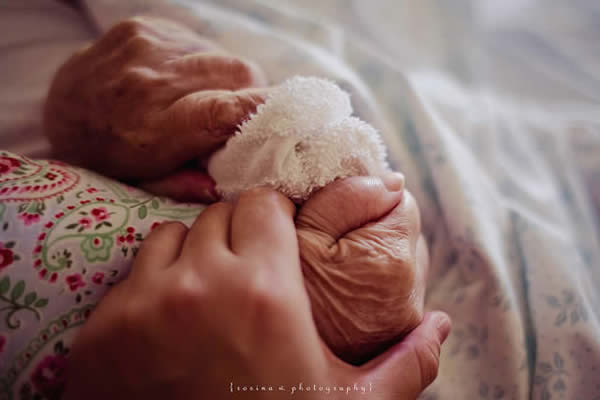 Grandmas Hold our Tiny Hands