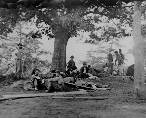 Wounded Soldiers Being Tended in the Field