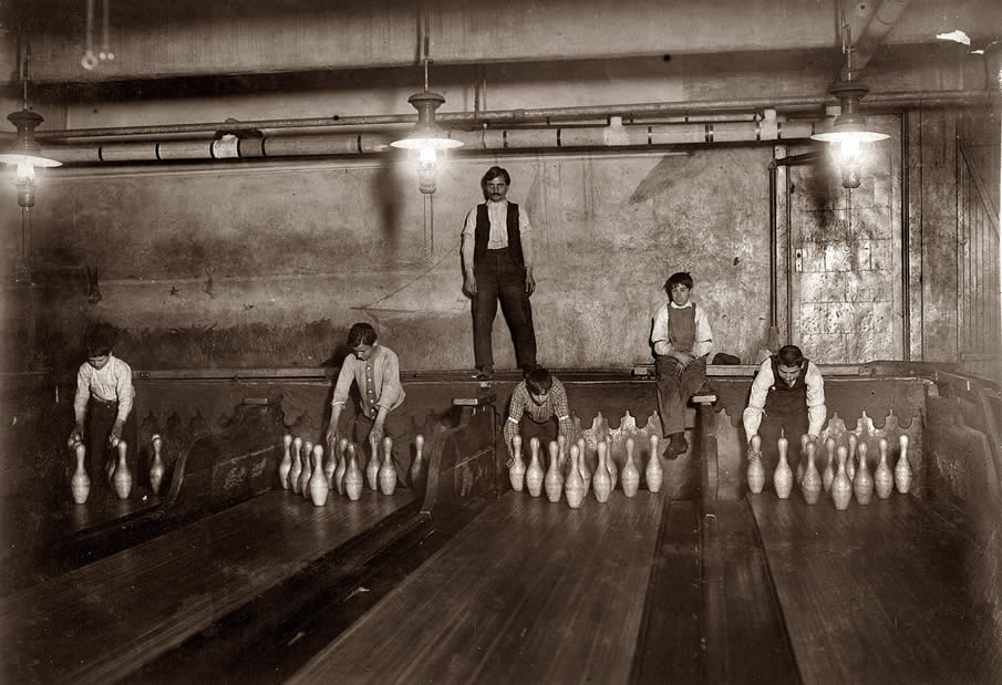 "April 1910. ""1 a.m. Pin boys working in Subway Bowling Alleys, 65 South Street, Brooklyn, N.Y., every night. Three smaller boys were kept out of the photo by Boss."""