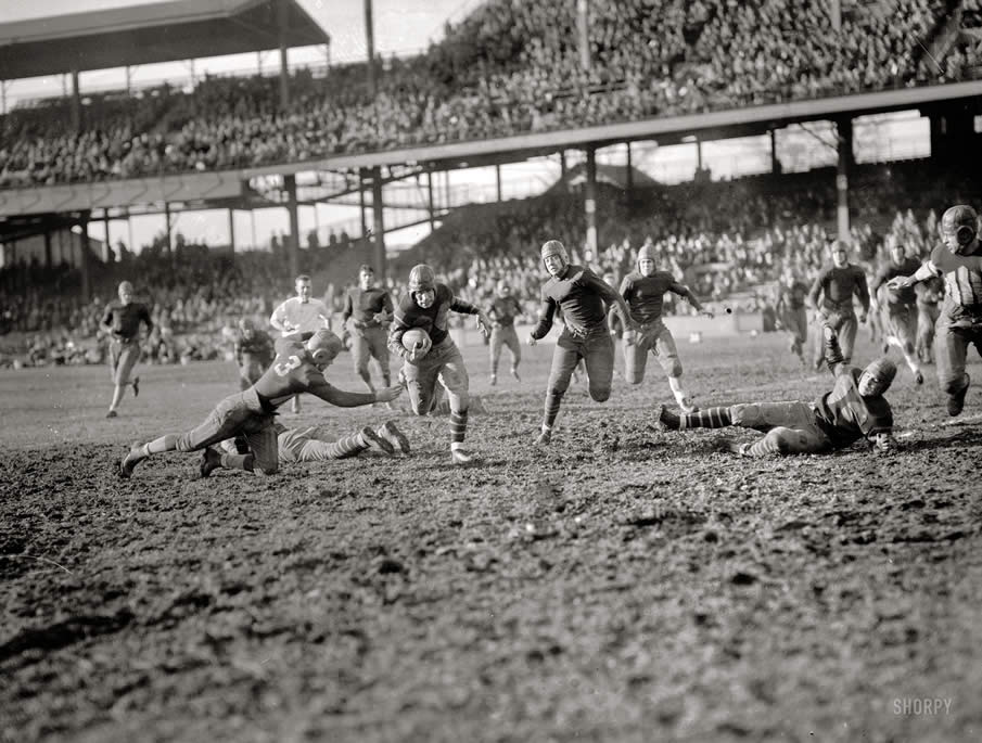 "November 14, 1925. ""Georgetown-Centre College game."" Georgetown University takes on Kentuckys ""Praying Colonels"" at Griffith Stadium in Washington, D.C."