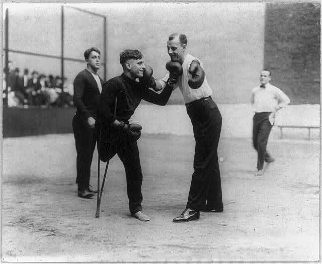 Sam Luzofsky (one leg) and Lon Young (one arm) boxing. 1912.