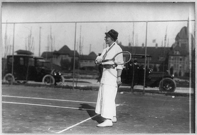 Mrs. T. Cassebeer holding tennis racket on court.