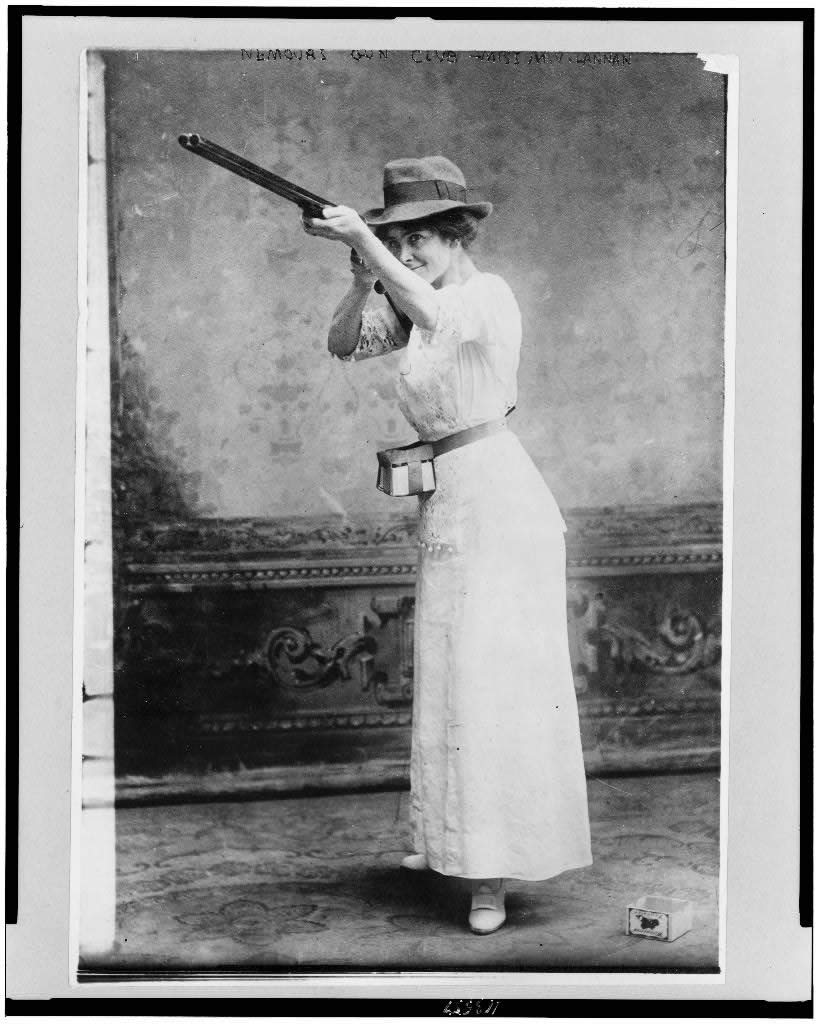 Woman posed with shotgun for trapshooting. 1914.