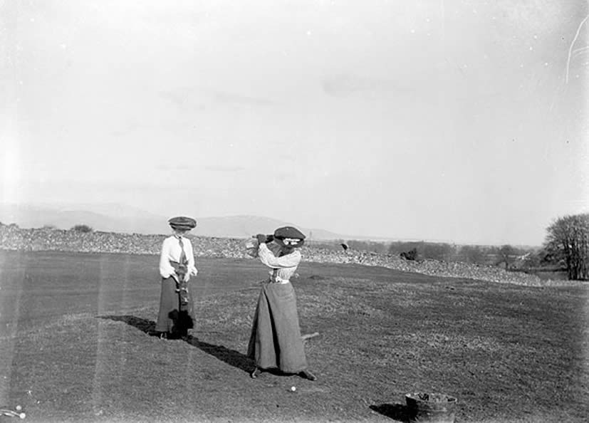 Two women playing golf on a links in Co. Louth.  Date: Circa 1907