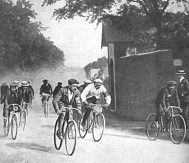 Cyclists ride in the first running of the Tour de France, in 1903. Maurice Garin, center with pale jersey, won the event.