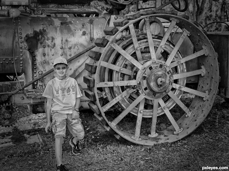 Boy by steam tractor