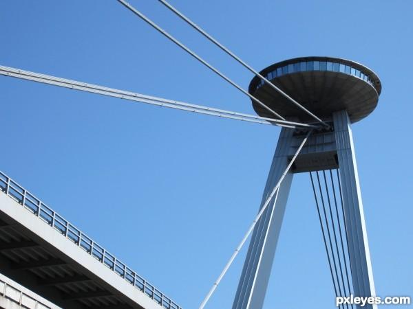 ufo landing on a bridge