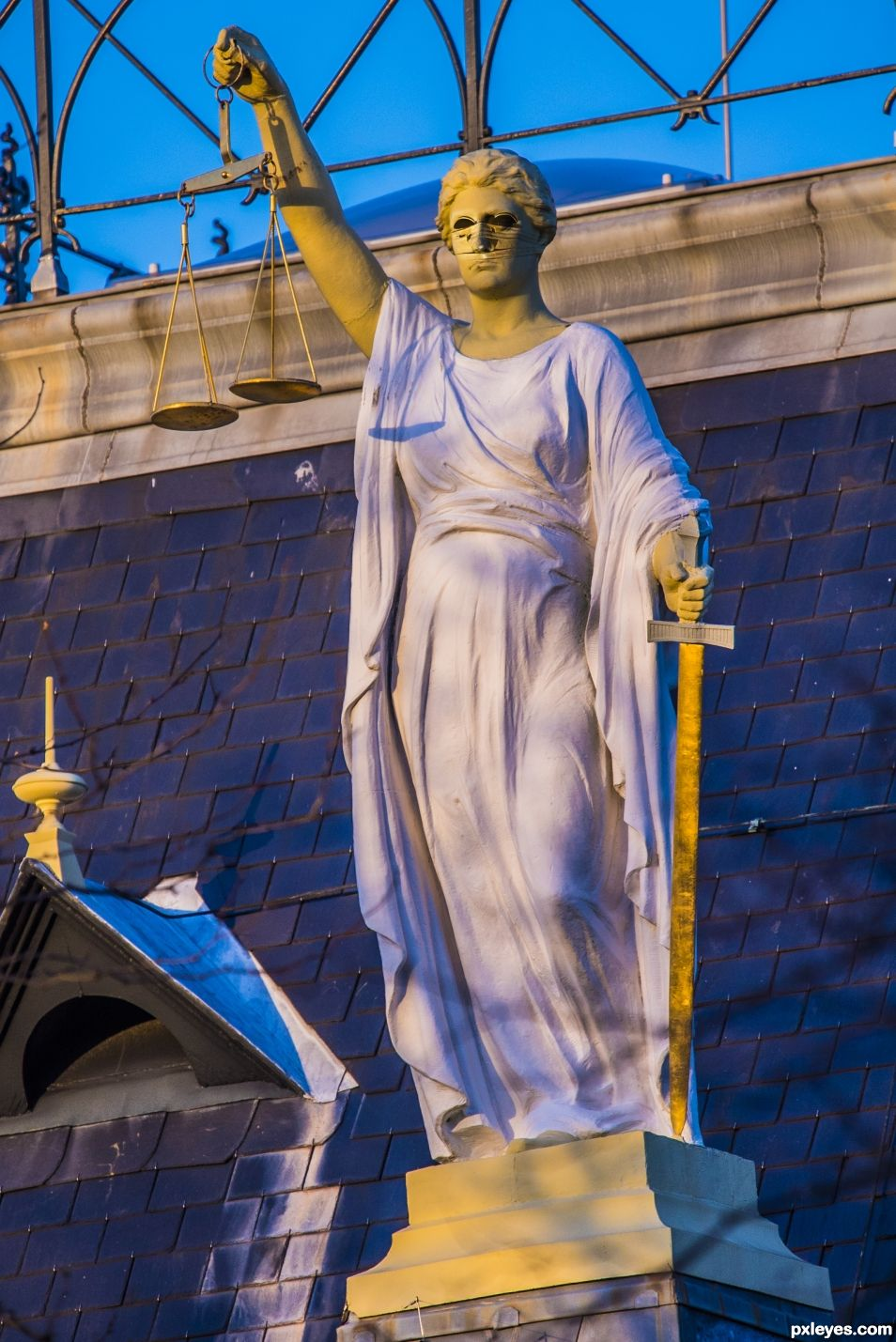 Lady justice blindfolded no more