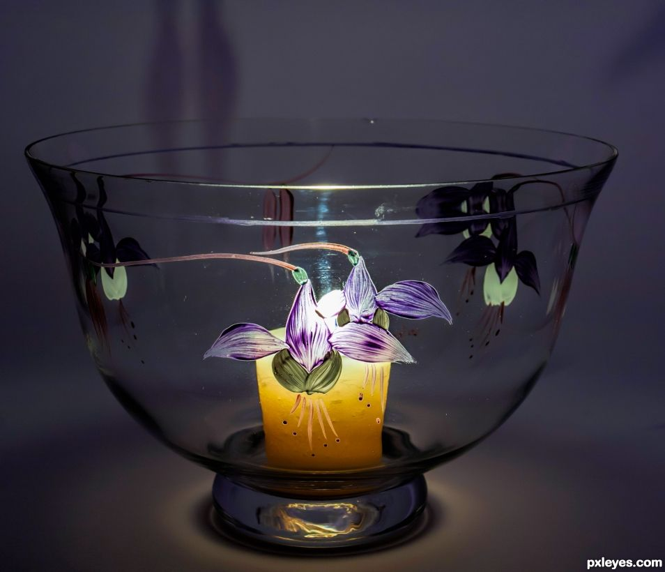 Glass bowl lit by candle