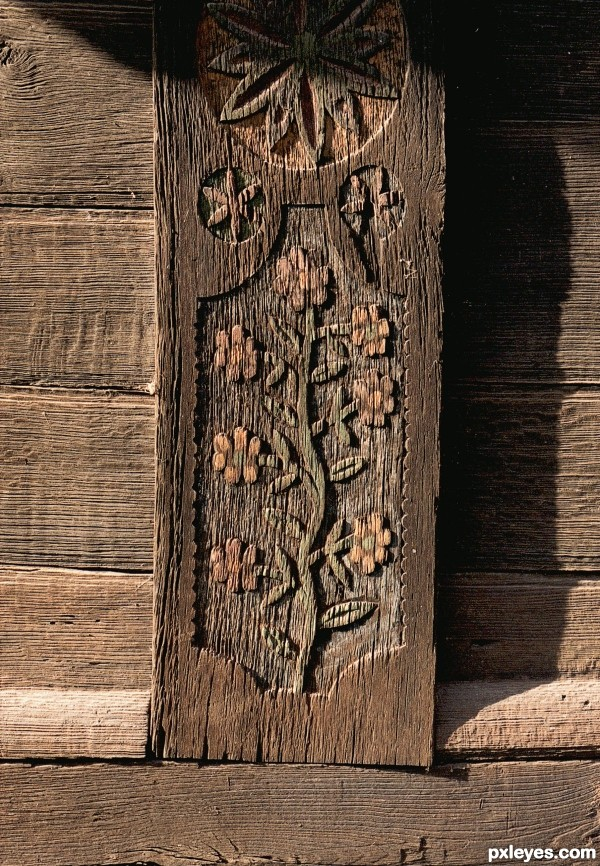 Old barn wood-carving