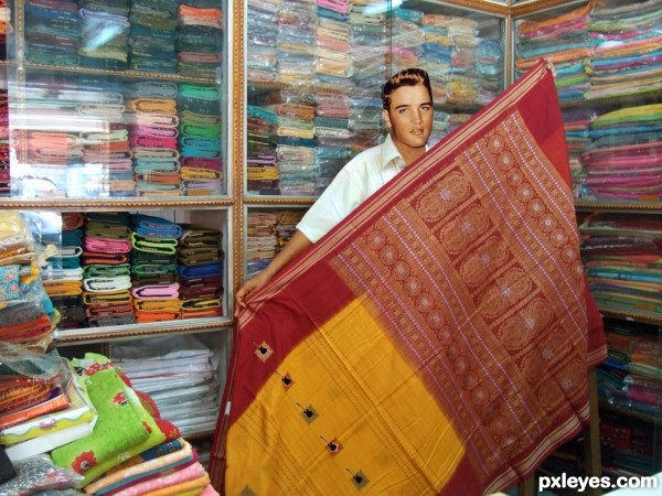 Elvis as sari shop owner