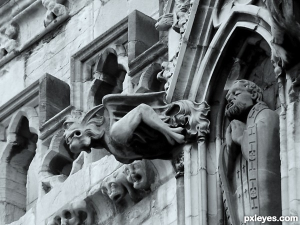 Originating During The Gothic Period Gargoyle Is A Primary Common Feature Among Buildings From