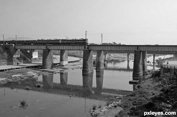 Train on old stone bridge