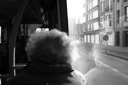Curly man on the bus