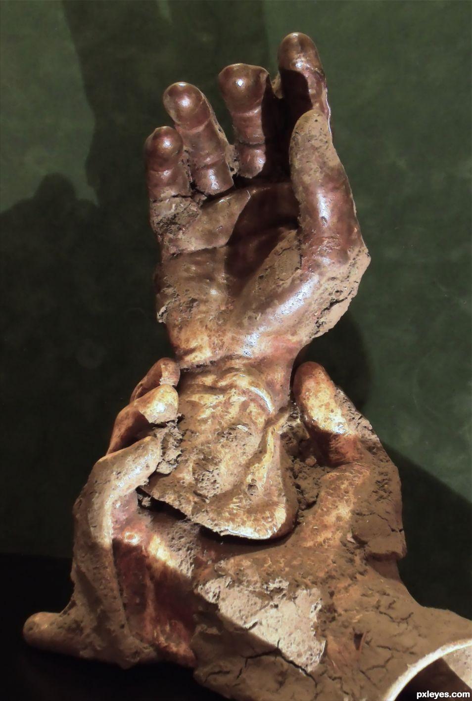One Hand Holding One Raising