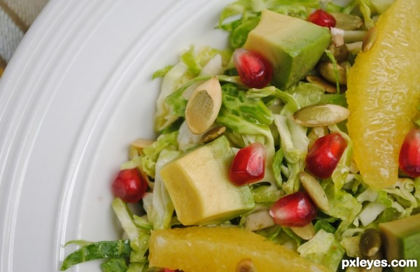 Raw Brussel Sprout, Avocado, Orange, and Pepitas Salad Close-up