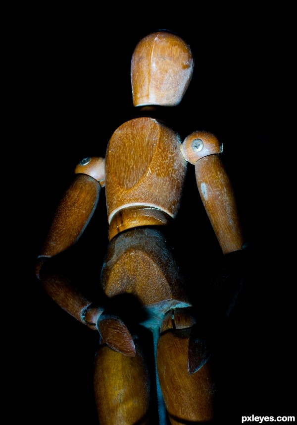 Old wooden mannequin