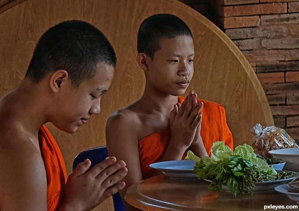 Monks Munch Meal in Monastery