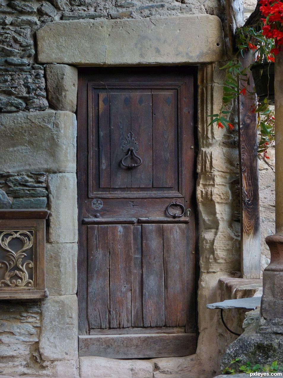 Old Stones, flowers and door