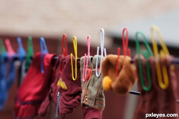 Mini clothespins for dolls clothes.