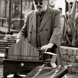 Barrel organ player Picture
