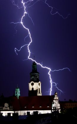 Church Illuminated by Lightning