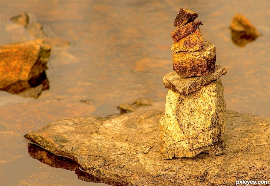 Small rocks stacked in a small stream