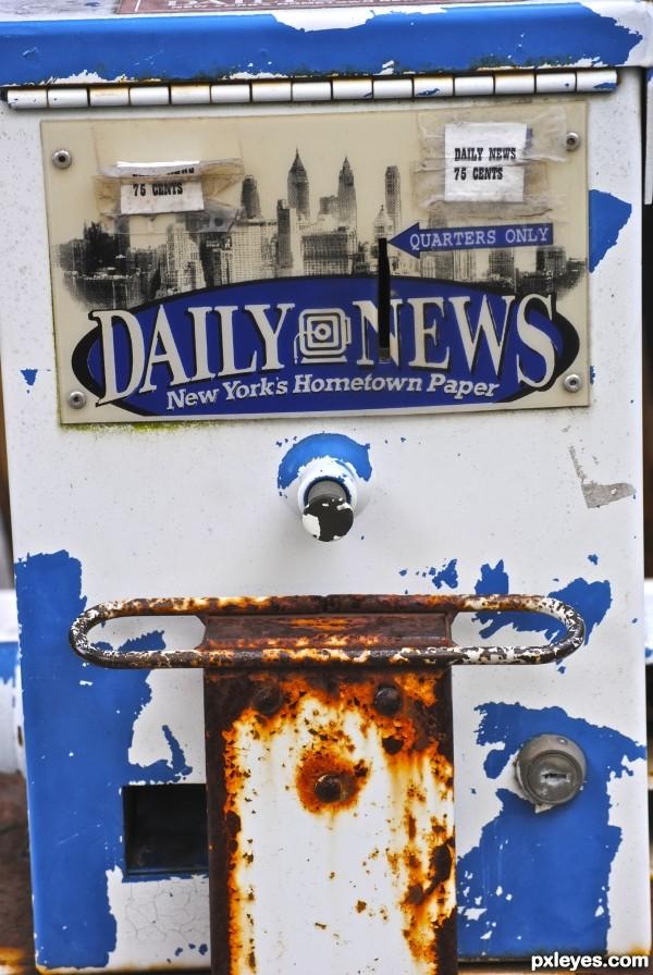 Old Newspaper Dispenser