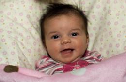 1 month old smiling ham