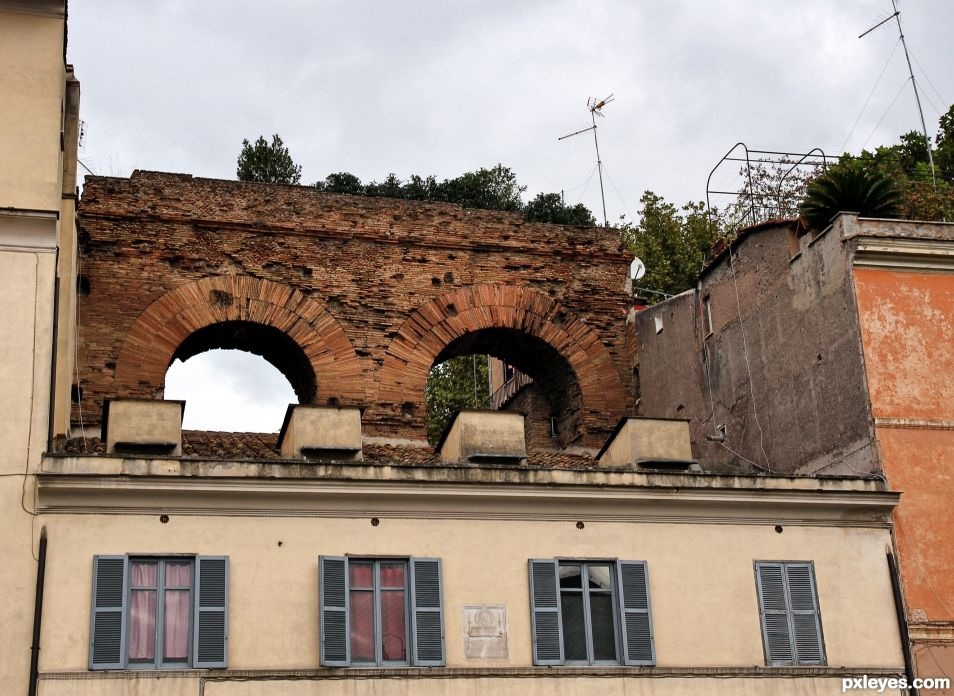 Roman arch and modern building