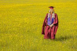 Graduate in a field of wild Spring flowers.