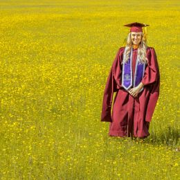 Graduate in a field of wild Spring flowers. Picture