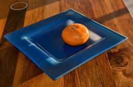 Blue plate with mandarine
