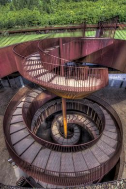 In a winery, a staircase in corkscrew ...