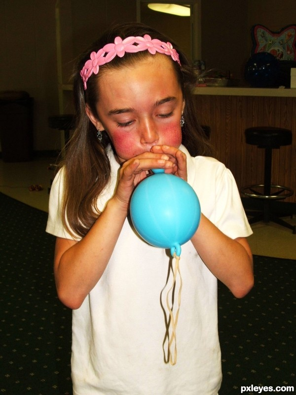 struggling to blow up balloon