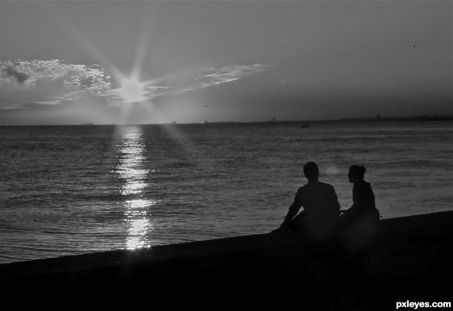 Lovers admiring Sunset