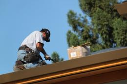 Roofer and his hammer Picture