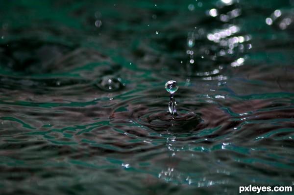 Rain hitting pool water